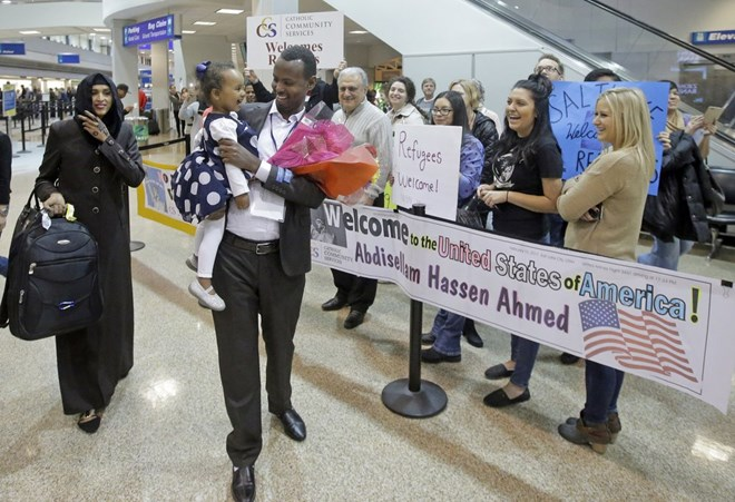 This Feb. 10, 2017, file photo, Abdisellam Hassen Ahmed, a Somali refugee who had been stuck in limbo after President Donald Trump temporarily banned refugee entries, walks with his wife Nimo Hashi, and his 2-year-old daughter, Taslim, who he met for the first time after arriving at Salt Lake City International Airport. President Trump appears to be ignoring a deadline to establish how many refugees will be allowed into the United States in 2021, raising uncertainty about the future of the 40-year-old resettlement program that has been dwindling under the administration. The 1980 Refugee Act requires presidents to issue their determination before Oct. 1, 2020, the start of the fiscal year. (Rick Bowmer, File/Associated Press)