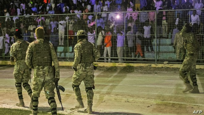 Somali security forces patrol during a soccer match at Konis Stadium, in Modadishu, Somalia, Sept. 8, 2017.