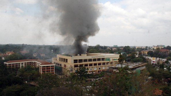 Heavy smoke is seen from the site of the terrorist attack, Westgate Mall, on September 23, 2013 in Nairobi, Kenya. (Photo by Wiiliam Oeri/Nation Media/Gallo Images/Getty Images)