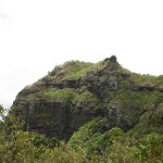 A distance photo of the giant's head; the closest rocky point is the nose, the flatter area behind it the head/forehead.