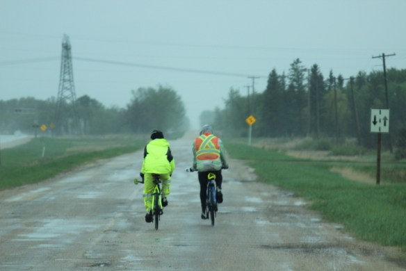 Two cyclists ride down a bumpy road to talk about mental health