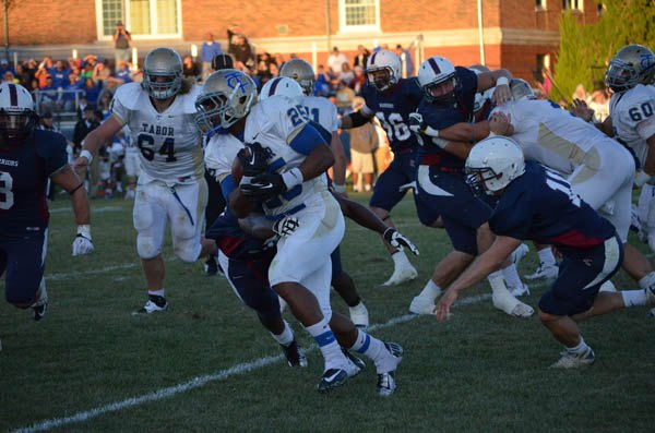 James Monroe (25) rushes for 6 yards during the second quarter. He carried the ball 34 times for 189 yards and four touchdowns. The Bluejays lost, 46-45, in overtime.