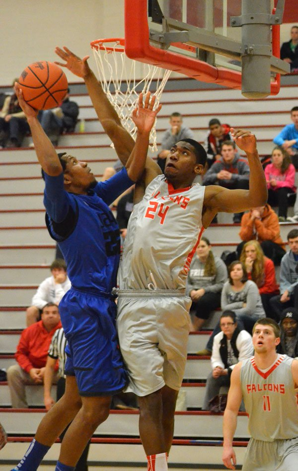 Robbie Samuel scores two points early in Tabor?s game at Friends Wednesday. Samuel scored 13 points in Tabor?s 78-74 win.