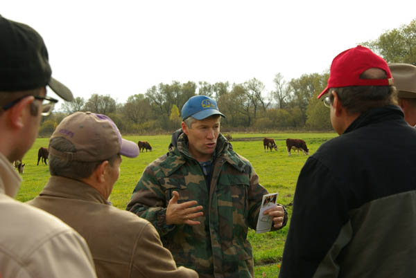 A group of people listened as the owner of DIK Herefords in Kaluga, Russia, spoke about the operation.