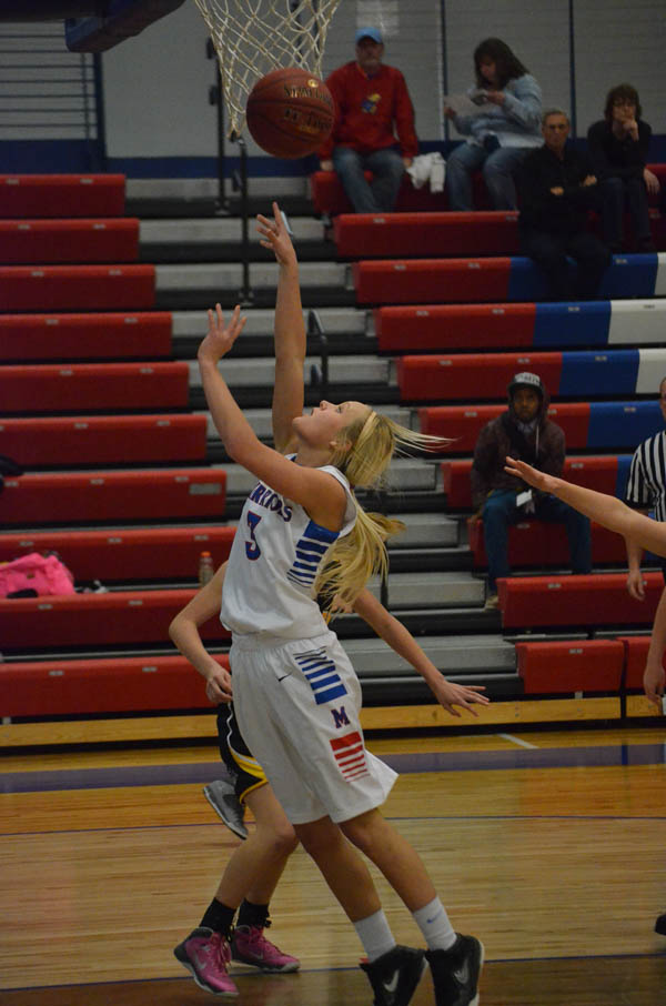 Katey Ehrlich scores to give Marion a 4-0 lead. Ehrlich scored the Warriors? first 11 points in Marion?s 42-25 win over Bennington and led the team with 18 points.