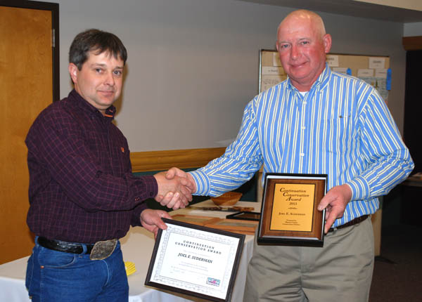 Joel Suderman (right) accepts the Continuation Conservation Award from Marion County Conservation District board supervisor Russell Funk.