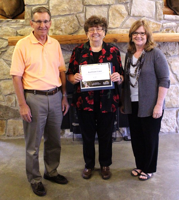 Owner of the Real Estate Center, receive their state merit awards Tuesday as part of KDOC?s Business Appreciation progra