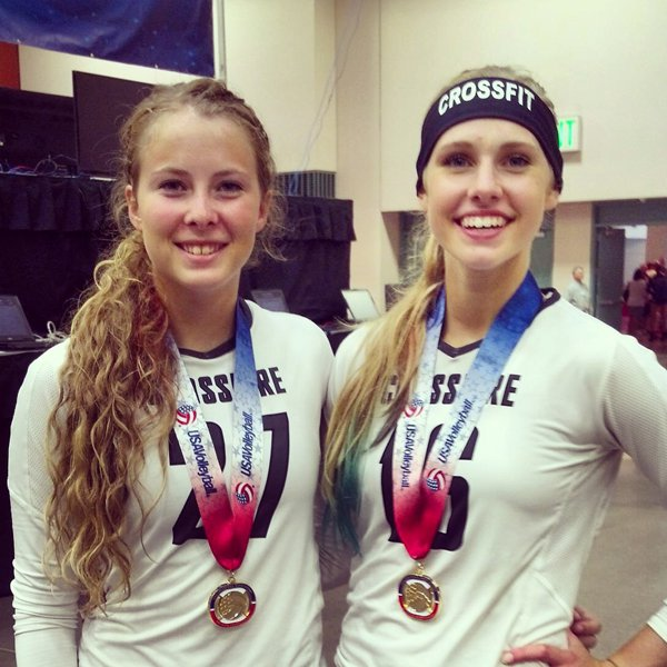 Shannon Heiser (left)?and Alex Ratzlaff of Hillsboro hold the championship trophy after their club volleyball team, Crossfire, won its division of USA Volleyball?s 2014 Girls? Junior National Championships in Minneapolis, Minn., last week. The seven-member club team is in its first year of existence and is coached by Amy Ratzlaff.