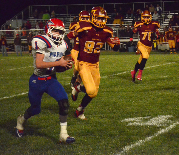 Bryce Shults runs for a 6-yard gain at the end of the third quarter Thursday at Mission Valley. With Marion leading 58-7 at halftime, the entire Warrior roster saw playing time in Marion?s 72-14 win.