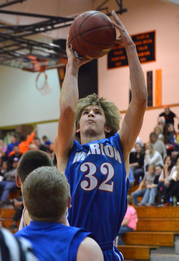 Jacob Baldwin shoots for two during the fourth quarter at Inman. Baldwin completed a three-point play to bring Marion within 36-35 with 6:19 to play.