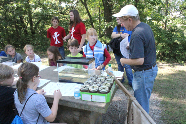 Lloyd Davies of Marion leads a station on macro invertebrates found in Marion County rivers during the 2014 EnviroFest for fourth-grade students of Marion County Sept. 17 at Brooker Central Park in Marion. About 140 fourth-graders and Centre?s fifth grade participated. The event included eight stations led by local experts. In addition to the Marion County Soil Conservation District, event sponsors included Marion Reservoir WRAPS, Marion County Farm Bureau Association and Carlson?s Grocery. Free Press file photo