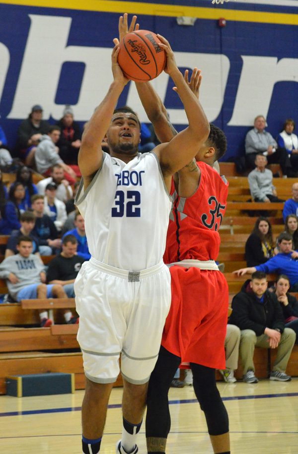 Lance Carter scores to give Tabor a 61-49 lead over McPherson Thursday. Carter had a double-double with 14 points and 10 rebounds.