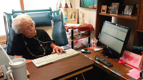 Amanda Ewert types another email from her room at Parkside Homes. A few days away from her 95th birthday, Ewert continues daily conversations with family and friends via the Internet after losing her hearing some 20 years ago. Courtesy photo by Rachel Behrends