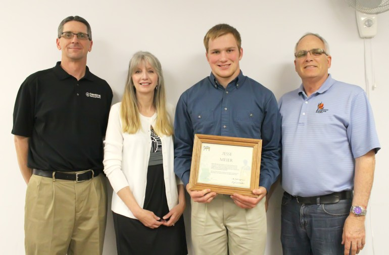 Hillsboro High School senior Jesse Meier is awarded the 16th annual $3,200 Marion County Agriculture Future of America Scholarship for 2015. Making the presentation May 12 are (from left) Mike Padgett from Central National Bank, Debi Owens from Midlands Farm Services of Hillsboro, and Lyman Adams, general manager of Cooper?a?tive Grain & Supply. Meier plans to attend Kansas State University to major in mechanical engineering. He is the son of Jon and Jill Meier of Hillsboro. Don Ratzlaff / Free Press
