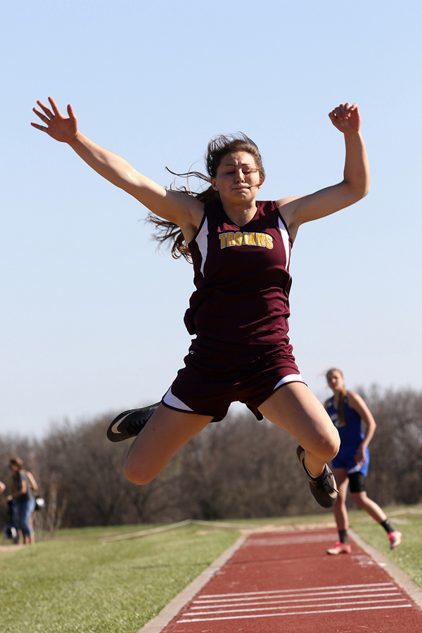 Hillsboro's Sienna Kaufman shows the form that led the Trojan senior to a first-place performance in long jump Friday. Her winning lead was 16 feet, 2.75 inches.