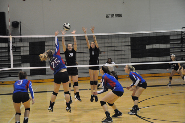 Lily Lundy attacks the net during Marion's match with Sterling at the Heart of America league tournament Saturday. The Warriors defeated the Black Bears in three sets, 25-22, 27-29, 25-21. Allison Shults/Special to the Free Press