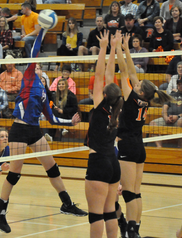 Laura Savage attacks the net during Marion's Class 2A sub-state quarterfinal match with Inman Saturday. The Warriors lost in three sets, 25-18, 24-26, 25-18, concluding the season with an overall record of 17-19. Allison Shults/Free Press