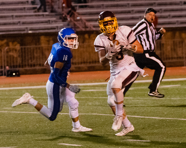 Brooks Gardner catches the ball and turned and scored for his second touchdown of the game against Pittsburg Colgan last week.