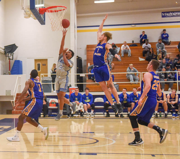 Darnell Jones-Bowie secures another two points for the Tabor Bluejays. He was the leading scorer during Saturday night's game against Bethany College. Photo by Michael Klaassen.
