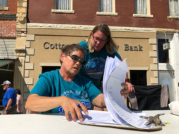 Donna Rosiere of Florence looks over the parade entries prior to the event on Monday. Standing behind her is Melanie Grimmett, committee member of the Labor Day celebration. Photos by Patty Decker/Free Press