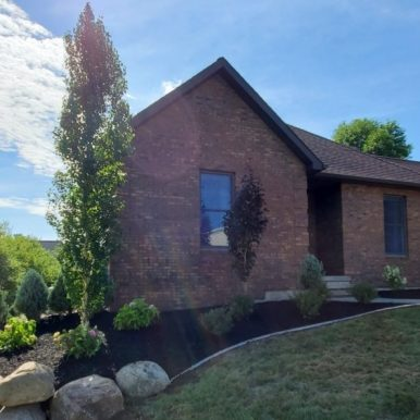 picture of house with landscaping in the front yard by Hillside Seasonal Services
