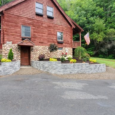 picture of a brown house with new landscaping done by Hillside Seasonal Services