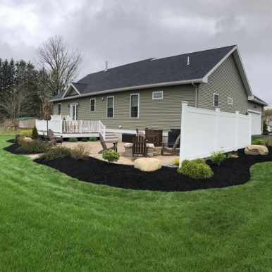 A backyard patio by Hillside Seasonal Services