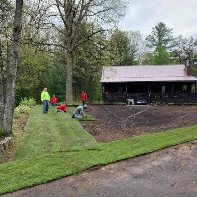 Hillside Seasonal Services employees working on a rolled lawn