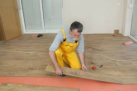 man doing floor renovation