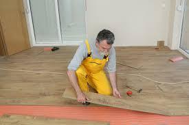man doing floor renovation