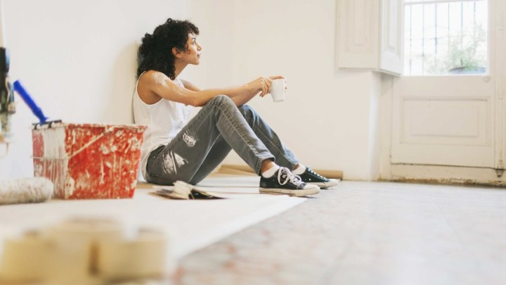 woman sitting down on the floor