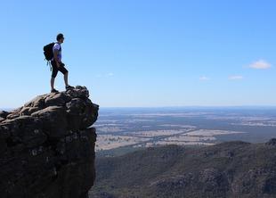 Man standing on a high peak