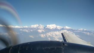 We're greeted with crystal views of the himalayas on our way to Pokhara.