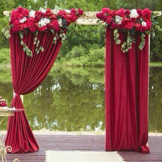Rustic Wedding Arch With Some Orange And Cream Flowers