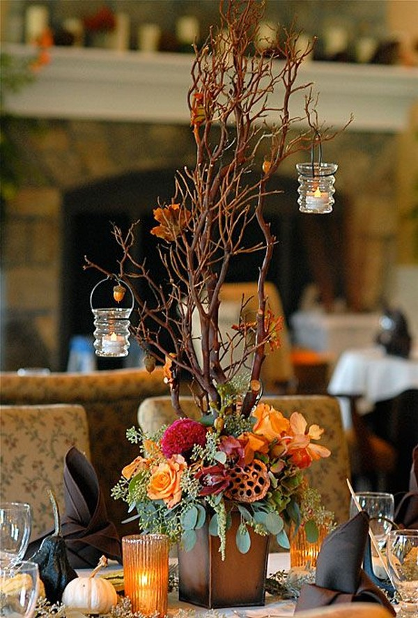 Arrangement of roses, celosia, cymbidium and vanda orchids, lotus pods, eucalyptus, and Manzanita branches