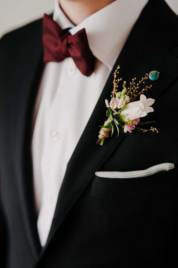 black fall and winter groom wedding suit and burgundy tie