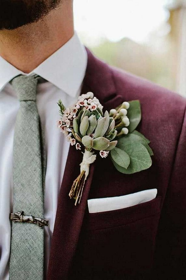 burgundy fall and winter groom wedding suit and sage green boutonniere