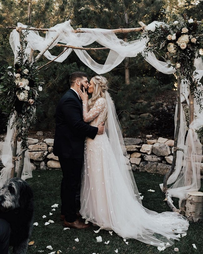 Bride And Groom Under Arch Wedding Photos #wedding #photos #weddingphotos #arches #weddingarches
