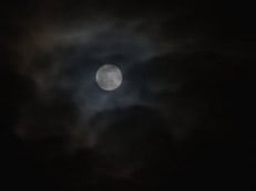 adam-jones-full-moon-and-passing-clouds-at-night