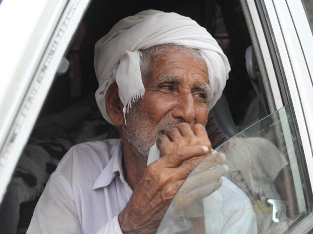 Father of social media celebrity Qandeel Baloch mourns as he sits in an ambulance carrying the body of Qandeel in Shah Sadar Din village, around 130km from Multan in Pakistan. (AFP Photo)