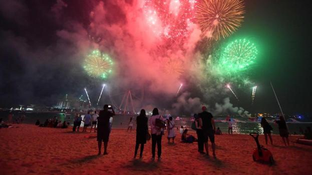 People watch fireworks in Dubai on the eve of the Muslim holiday of Eid al-Adha. (Giuseppe cACACE / AFP)