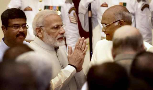 Prime Minister Narendra Modi exchanges greetings with President Ram Nath Kovind and new cabinet ministers after the reshuffle at Rashtrapati Bhavan in New Delhi on Sunday.