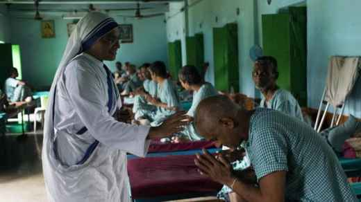 A patient pays respect to a nun at the Gandhiji Prem Nivas, a leprosy centre conducted by Missionaries of Charity in Titagarh, north of Kolkata.