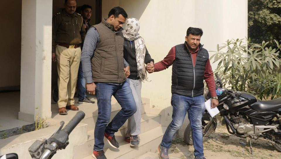 The boy who killed his mother and sister being taken by police personnel for medical tests in Greater Noida. (Sunil Ghosh/HT Photo)