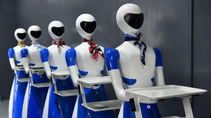 "Service robots line up in a corridor on the opening day of the ""Robot"" restaurant. These robots were earlier introduced in Chennai and Coimbatore. (Manjunath Kiran / AFP)"