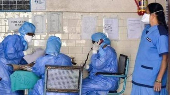 File photo: Medics outside an isolation ward of the coronavirus at a hospital.