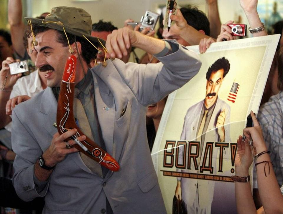 FILE PHOTO: British actor Sacha Baron Cohen, in character as a Kazakh TV reporter known as 'Borat', holds a boomerang as he mingles with fans in Sydney November 13, 2006 during the Australian premiere of his film