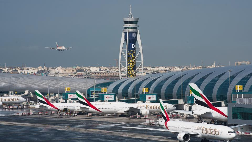 FILE - In this Dec. 11, 2019 file photo, an Emirates jetliner comes in for landing at Dubai International Airport in Dubai, United Arab Emirates. The airport is getting busier but it's a long way from what it once was amid the coronavirus pandemic. To boost those numbers, airport CEO Paul Griffiths is urging countries to move away from mandatory quarantines on arriving passengers and toward the strategy embraced by Dubai. That includes aggressive coronavirus testing before departure, followed by mandatory mask-wearing on aircraft.