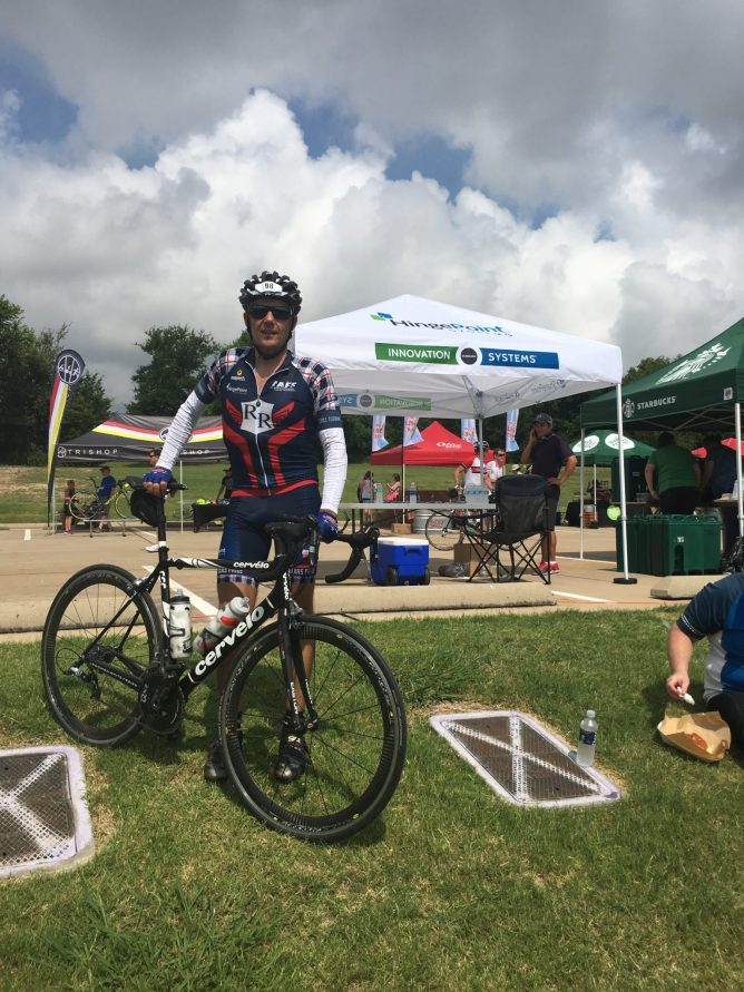 Bryce Finnerty in Front of Hingepoint Tent at 2016 Collins Bike Rally