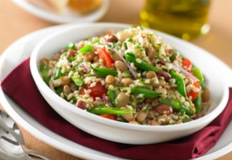 mixed bean rice salad in a white bowl